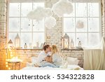 Happy Couple In White Room Wit...