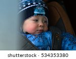 little boy in winter clothes in ... | Shutterstock . vector #534353380