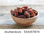 dried date fruit in bowl on the ... | Shutterstock . vector #534357874