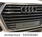 Small photo of Berlin, Germany - December 11, 2016: diesel-powered plug-in-hybrid SUV, the Audi Q7 e-tron car, front view. Audi AG is a premium German automobile manufacturer that produces luxury automobiles