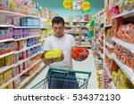 young caucasian man make choose ... | Shutterstock . vector #534372130