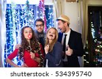 Stock photo hipster friends celebrating new years eve together photobooth p 534395740