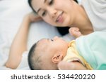 happy young mom and baby lying... | Shutterstock . vector #534420220