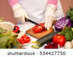 woman with gloves cutting... | Shutterstock . vector #534427750