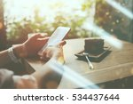woman holding mobile phone with ... | Shutterstock . vector #534437644