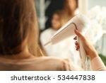 hairdresser holding hair dryer | Shutterstock . vector #534447838