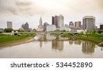 Small photo of Iconic bridge and Columbus Ohio skyline in the rain