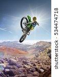 dirt bike rider flying high on... | Shutterstock . vector #534474718