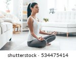 time for yoga. attractive young ... | Shutterstock . vector #534475414