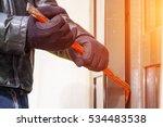 burglar trying to break into a...