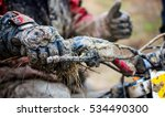 Crazy motocross in mud close-up