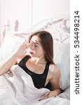 Small photo of Young woman in bed with headache portrait. Beautiful girl woke up in morning with migraine, free space. Seasonal illness, blow ague, stress, health care concept