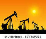 silhouette of working oil pumps ... | Shutterstock .eps vector #534569098