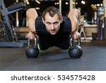 athletic guy doing exercise... | Shutterstock . vector #534575428