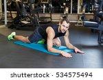athletic guy doing exercise... | Shutterstock . vector #534575494