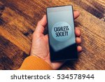 Small photo of Cashless society concept, man using smartphone for electronic payment and online business transactions