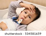 sick boy lying in bed with a... | Shutterstock . vector #534581659