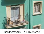 A Balcony With Wooden Doors An...