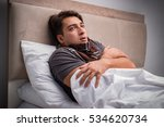 sick man resting in the bed | Shutterstock . vector #534620734