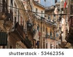 cluttered havana backstreet - stock photo