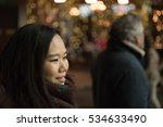 An Asian Girl Wearing A Scarf...