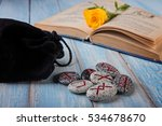 stone runes and old book on the ... | Shutterstock . vector #534678670