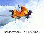 man climbing frozen waterfall. | Shutterstock . vector #534727828
