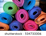 pile of colorful yoga mats  | Shutterstock . vector #534733306