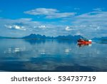 Red Fishing Boat Sailing On...