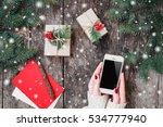 female hands holding mobile...   Shutterstock . vector #534777940