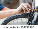 mechanic repair bicycle in... | Shutterstock . vector #534792436