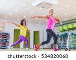 two smiling female fitness... | Shutterstock . vector #534820060