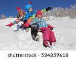 three kids  ride in the snow on ... | Shutterstock . vector #534859618