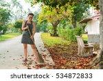 Woman In The Garden. Happy...