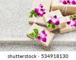 gifts with orchids. presents... | Shutterstock . vector #534918130