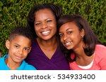 single mother and her children. | Shutterstock . vector #534933400