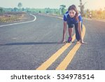 woman getting ready to start on ... | Shutterstock . vector #534978514