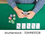 chips and cards for poker in... | Shutterstock . vector #534985528