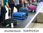 suitcase on luggage conveyor... | Shutterstock . vector #534992524