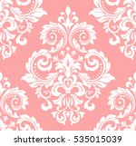 Floral pattern. Wallpaper baroque, damask. Seamless vector background. Pink and white ornament..