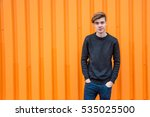 Smiling teen boy in black over...