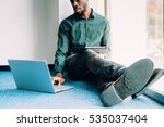 young afro businessman sitting... | Shutterstock . vector #535037404