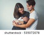 woman and man holding a newborn.... | Shutterstock . vector #535072078