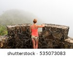 Adventurous young woman on top of Torre Britton in the beautiful jungle of the El Yunque national forest in Puerto Rico