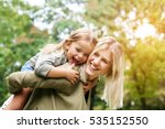 cute young daughter on a piggy... | Shutterstock . vector #535152550