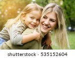 cute young daughter on a piggy... | Shutterstock . vector #535152604
