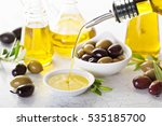 Small photo of Olive oil in vintage bottles and small bowl