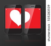 two cell phones with one heart... | Shutterstock .eps vector #535283539