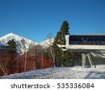 Cable car station, snowy Caucasus mountains, ski resort, Russia - stock photo