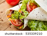 fresh wraps on wooden... | Shutterstock . vector #535339210